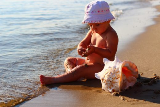 baby on the sand at the beach
