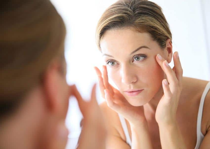 Over 40 skin care - Middle-aged woman applying anti-aging cream
