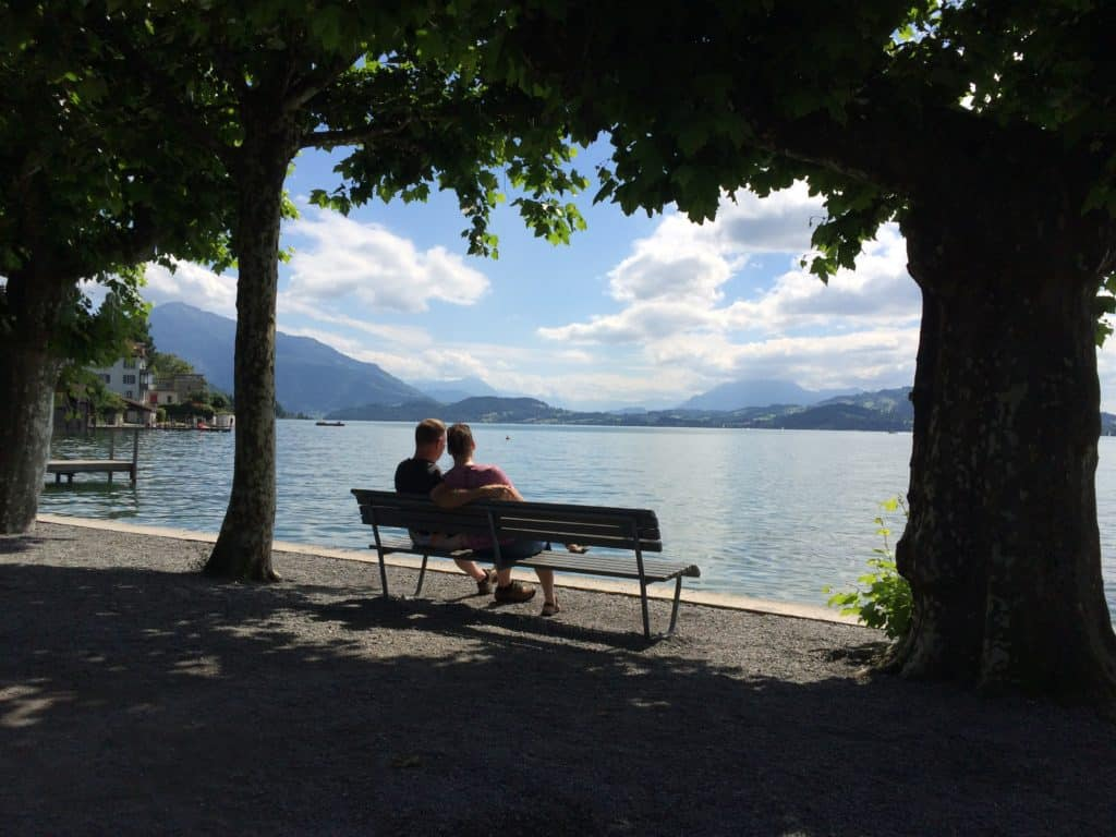 starting a business when you least expect it: the surprise entrepreneur - couple on a bench by Lake Zugg