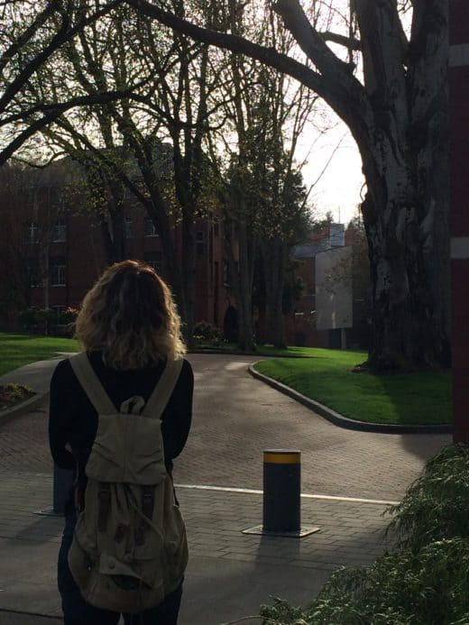 girl on college campus with backpack