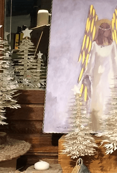 Christmas angel painting with white Christmas trees and candles