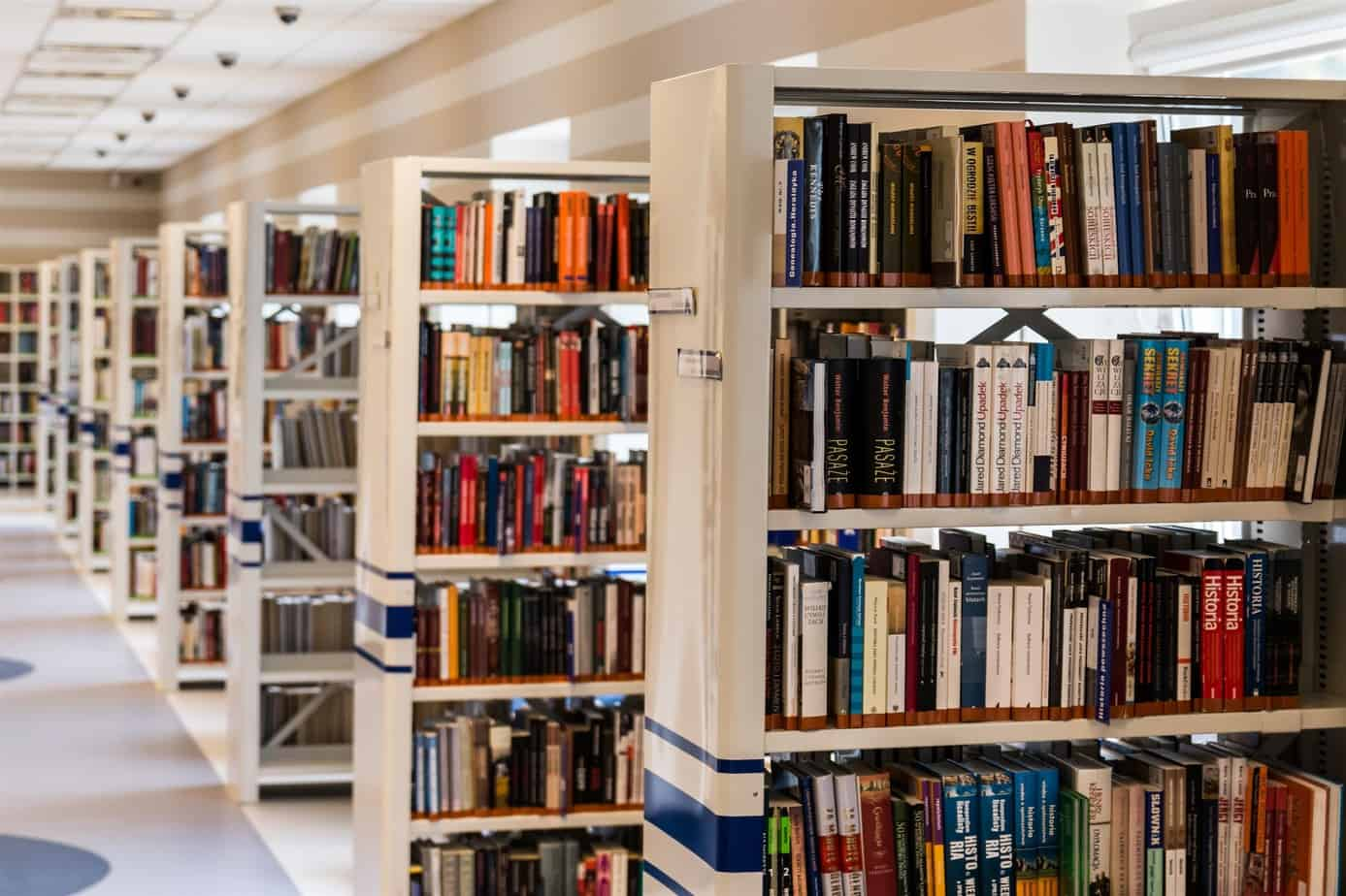 rows of bookshelves with books at a library