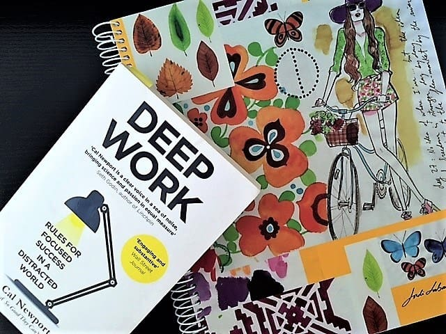 "Floral planning notebook and copy of book called ""Deep Work""-- to help with concentration and productive work"