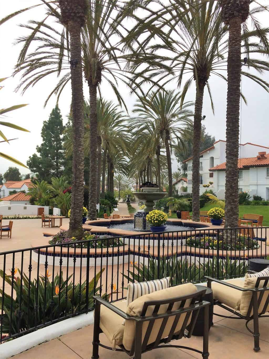 Majestic fountain surrounded by palm trees- Omni Resort La Costa