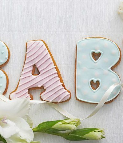 Cookies for baby shower in letters spelling baby colored pink and blue.