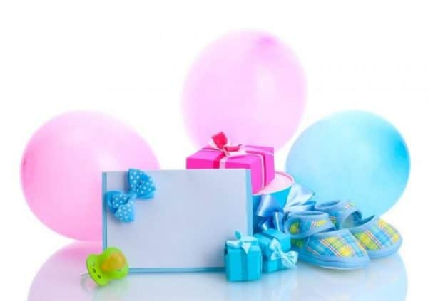 baby shower gifts wrapped in pretty blues and pinks with balloons