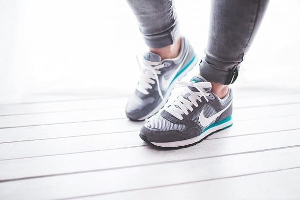 Top view of tennis shoes walking - moving more helps weight loss