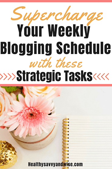 Pink flowers and notebook on desk for Pinterest graphic-Seven Priority Tasks to Include in Your Weekly Blogging Schedule