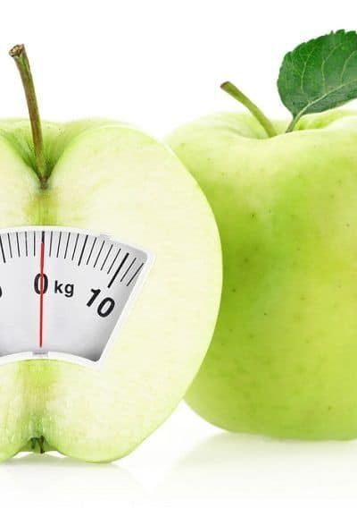 two green apples - one with scale reading on the front