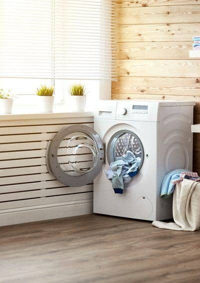 Bright laundry room with wood panels and white shelving - laundry room organization